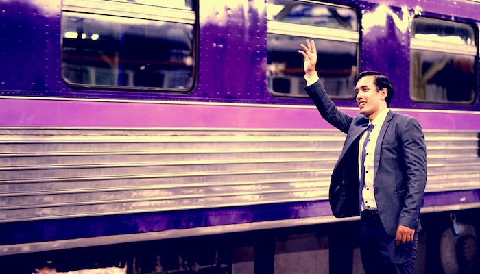 Businessman waving Goodbye