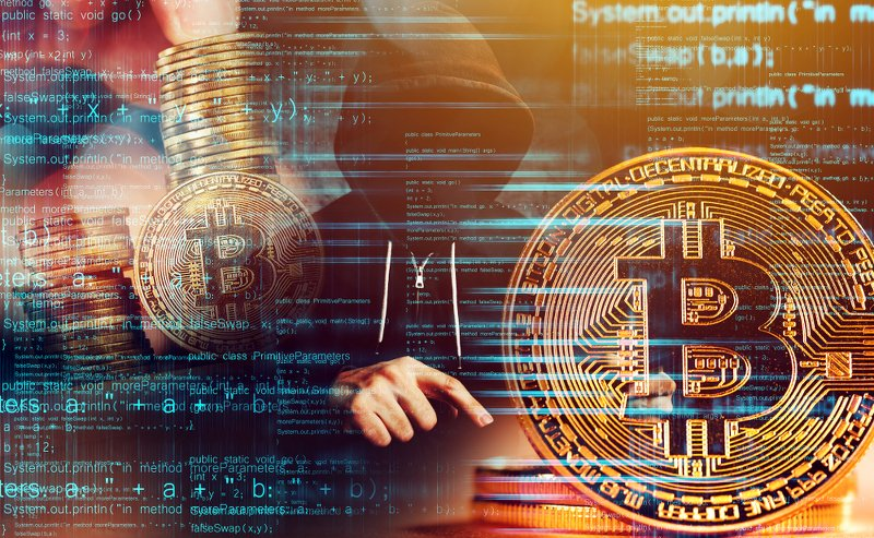 Hacker mit Bitcoins